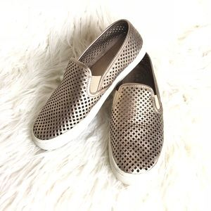 Tory Burch slip on perforated gold sneakers